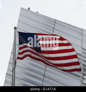 The Stars and Stripes flies outside of the National September 11 Memorial and Museum in New York City, USA. - Stock Photo