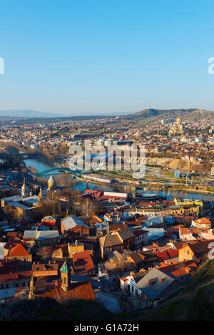 Eurasia, Caucasus, Georgia, Tbilisi, city view, Bridge of Peace and Tbilisi Sameda Cathedral, Presidential palace, - Stock Photo