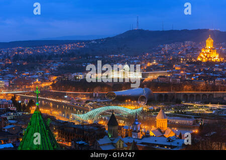 Eurasia, Caucasus region, Georgia, Tbilisi, city view, Presidential Palace, Sameda Cathedral; Bridge of Peace on - Stock Photo