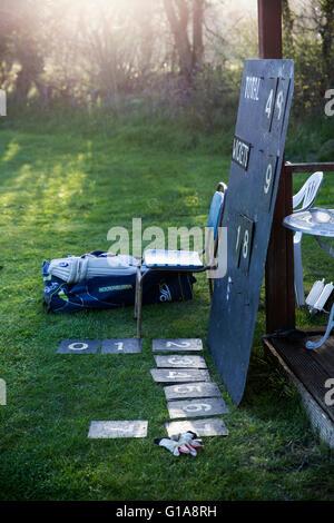 village cricket  scoreboard.park, green, garden, oak, golf, tree, meadow, club, nobody, lawn, course, grass, village, - Stock Photo