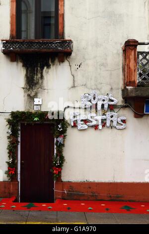 Boas Festas greeting and Christmas decorations outside house, Vila Praia de Ancora, Minho Province, northern Portugal - Stock Photo