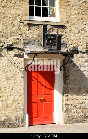 An old Post Office and Savings Bank sign above a red door in the village of Woodstock in Oxfordshire - Stock Photo
