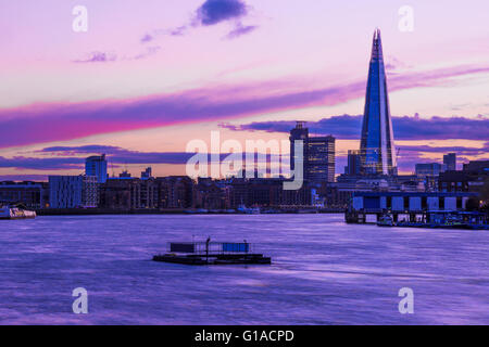 Modern London cityscape during sunset, including The Shard - Stock Photo