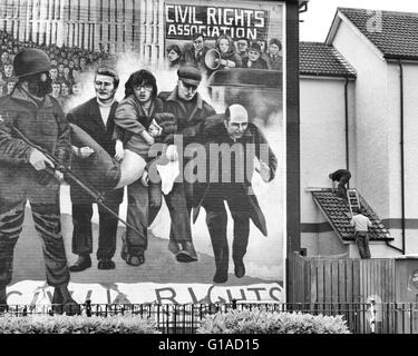 The Bloody Sunday mural showing catholic priest Edward Daly (later to become Bishop Daly) waving a white handkerchief. - Stock Photo