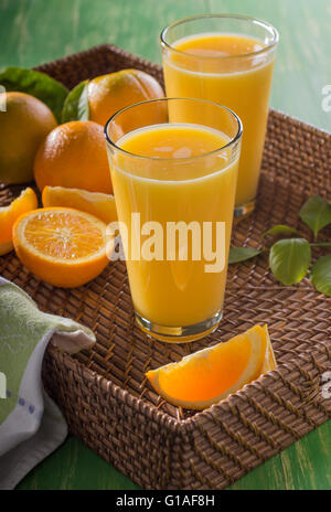 Two Glasses of Freshly Squeezed Orange Juice on Serving Tray - Stock Photo