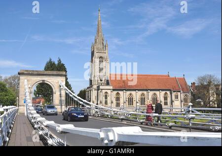 Bucks - on Marlow 19c suspension bridge - view to All Saints parish church - traffic and walkers -  spring sunshine - Stock Photo
