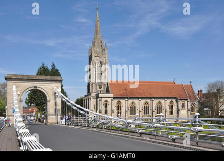 Bucks Marlow - on Marlow suspension bridge over river Thames - view of bridge and All Saints parish church - sunshine - Stock Photo