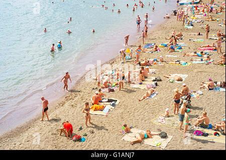 People at a sea beach in Sudak. Crimea - Stock Photo