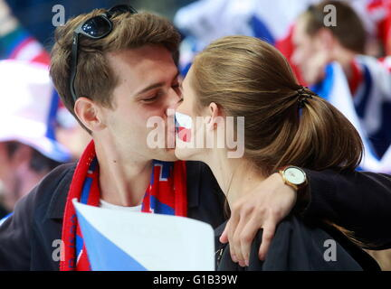 MOSCOW, RUSSIA. MAY 12, 2016. Czech Republic's fans kiss as they root for their team in the 2016 IIHF World Championship - Stock Photo