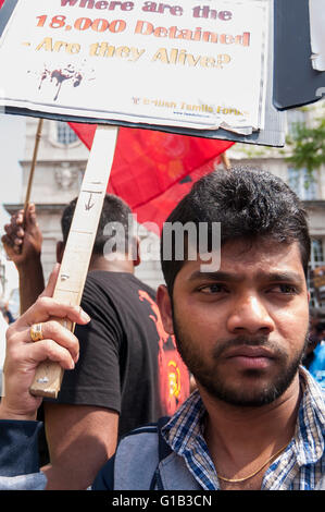 London, UK.  12 May 2016.  Tamil demonstrators gather in Pall Mall to make their views known as Prime Minister, David Cameron, and other G20 leaders meet in nearby Lancaster House for the Anti-Corruption Summit 2016. Credit:  Stephen Chung / Alamy Live News