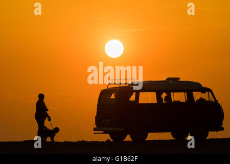 Clarach, near Aberystwyth , Wales UK.,  Thursday 12 May 2016   UK weather: A spectacular sunset over a woman walking - Stock Photo
