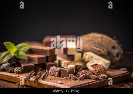 Homemade chocolate bars on wooden background - Stock Photo