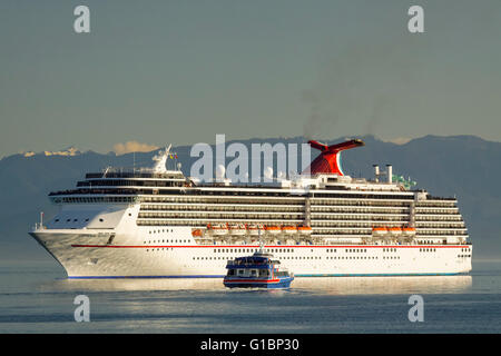 Victoria Clipper ferry and Carnival Spirit cruise ship in Juan de Fuca Strait-Victoria, British Columbia, Canada. - Stock Photo