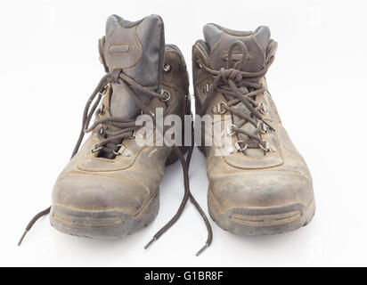 Dusty well worn hiking boots isolated on white background - Stock Photo