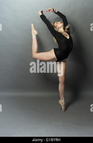 Beautiful ballet dancer doing an arabesque - Stock Photo