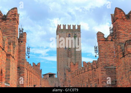 The Castel Vecchio Bridge or Scaliger Bridge, a fortified bridge in Verona, northern Italy, over the Adige river - Stock Photo