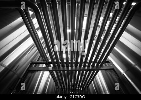 Stainless steel tank at the winery for wine - Stock Photo