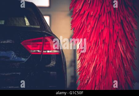Brush Car Wash Car Cleaning. Red Car Wash Brushes Ready to Use. - Stock Photo