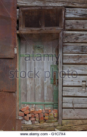 ... old wooden door in a wall collapsing house - Stock Photo & Blue Door and Broken Window in the Locker room of a Derelict and ...