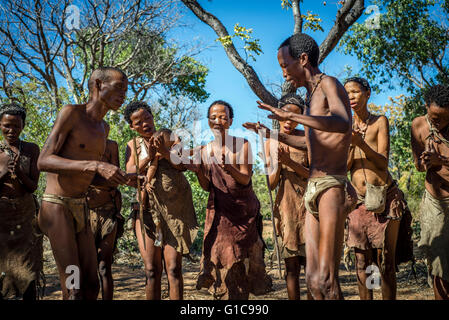 Traditional dancing and singing in the Living Museum of the Ju'Hoansi-San, Grashoek, Namibia - Stock Photo