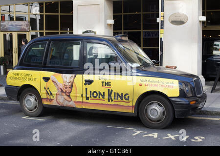 A famous London Black cab advertising The Lion King - Stock Photo