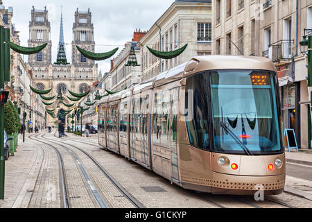 Brown tram on Rue Jeanne d'Arc in Orleans, France - Stock Photo