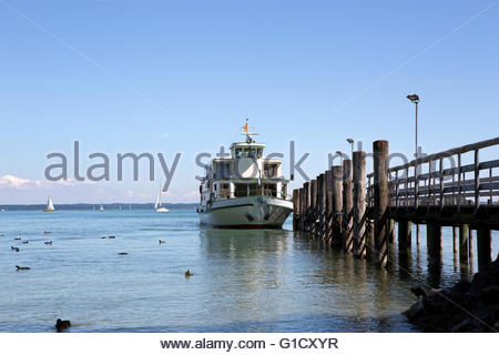 Steamship at the pier at isle Chiemsee in Bavaria, Germany - Stock Photo