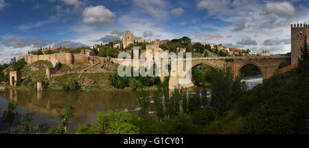 Panoramic view Puente de San Martin bridge over the Tagus river, Rio Tajo, Toledo, Castile–La Mancha, Spain, - Stock Photo