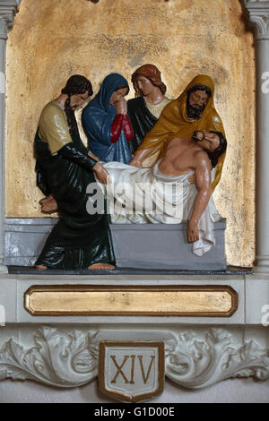 Way of the cross. Station 14. Jesus is laid in the tomb. AmbŽrieux-en-Dombes. France. - Stock Photo