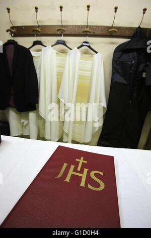 Bible and liturgical clothes. Sacristy. Sanctuary of La Benite Fontaine. La Roche-sur-Foron.  France. - Stock Photo