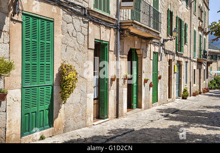 Building with green doors and shutters in the mountain village Valldemosa, Majorca, Spain - Stock Photo