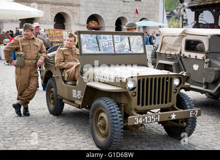 Soldiers reenactors at Rally VI military vehicles from World War II in Kazimierz Dolny, Poland, antique army Willys - Stock Photo