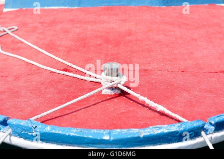 Marine rope on wooden boat - Stock Photo