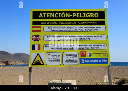 Beach danger sign Los Escullos, Cabo de Gata national park, Almeria, Spain - Stock Photo