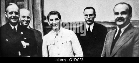 Photographic print of Joachim von Ribbentrop (1893-1946), Joseph Stalin (1878-1953), and Vyacheslav Molotov (1890 - Stock Photo