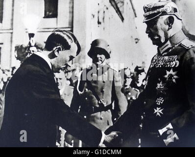 Photographic print of President Paul von Hindenburg (1847-1934) shaking hands with Adolf Hitler (1889-1945) in Poland. - Stock Photo