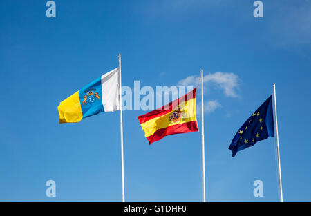Flags of the European Union, Spain and Canary Islands flying at the airport, Lanzarote, Canary islands, Spain - Stock Photo