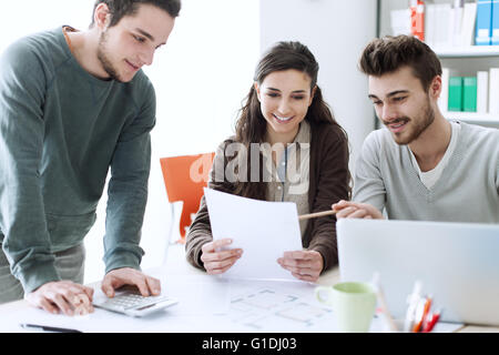 College students working together on a project, education and learning concept - Stock Photo