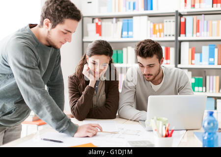 College students working together on a design project, education and learning concept - Stock Photo