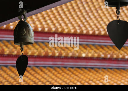 Wat Benchamabophit (Marble Temple).  Brass buddhist bell hanging under the temple roof.  Bangkok. Thailand. - Stock Photo