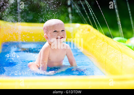 Baby swimming in kid inflatable pool isolated on white for Baby garden pool