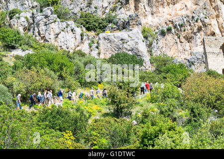 NORTH CYPRUS SAINT HILARION TOURISTS ON THE PATH TOWARDS THE CASTLE - Stock Photo