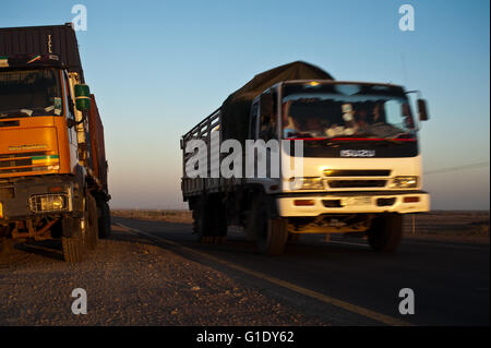Heavy goods vehicles plying on the road connecting Ethiopia with the port of Djibouti ( Afar state, Ethiopia) - Stock Photo