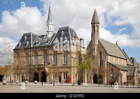 The Town Hall in Bishop Auckland , a Gothic style Victorian Building overlooking the market place at the centre - Stock Photo