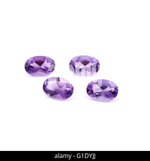 Brazilian Faceted Amethyst on a white background. - Stock Photo