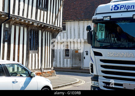 Car and lorry in the village of Lavenham, Suffolk, England UK - Stock Photo