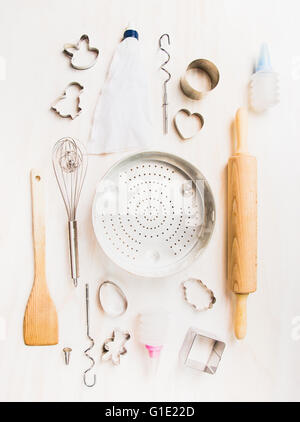 various kitchen tools selection for easter baking on white wooden background, top view - Stock Photo