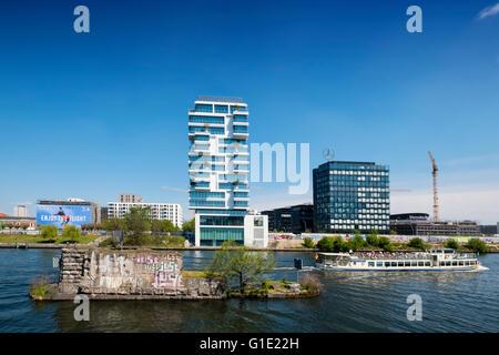 New luxury high-rise apartment building built beside Berlin Wall on River Spree in Friedrichshain Berlin Germany - Stock Photo