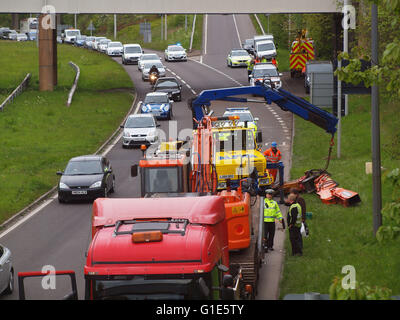 Newcastle Upon Tyne, 13th May 2016.  An excavator  on a low loader impacts a metro rail bridge on the A19 Tyne Tunnel - Stock Photo