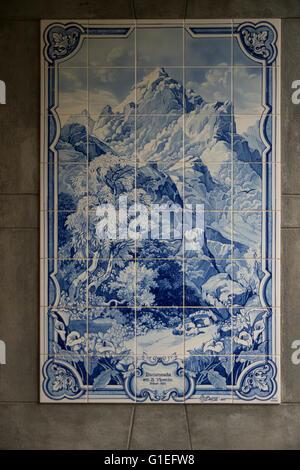 Historic azulejos (tiles) at the Grutas (Caves) de Sao Vicente, Madeira, Portugal. Blue and white ceramic tiles. - Stock Photo